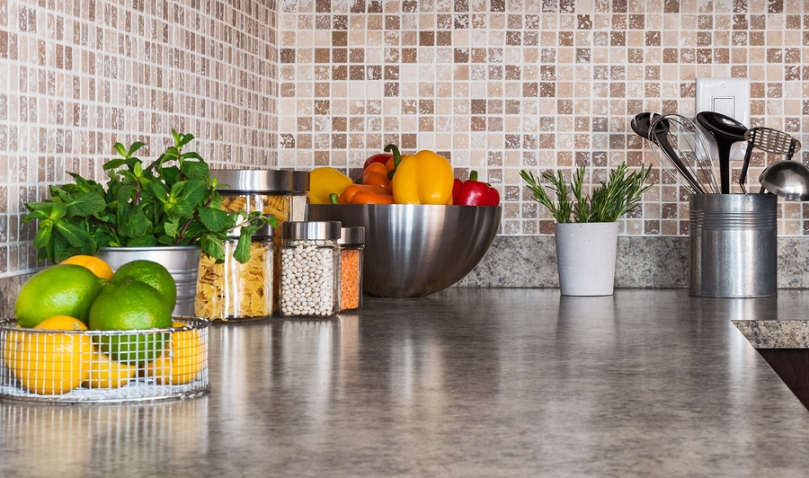 Kitchen Countertop With Food Ingredients And Herbs